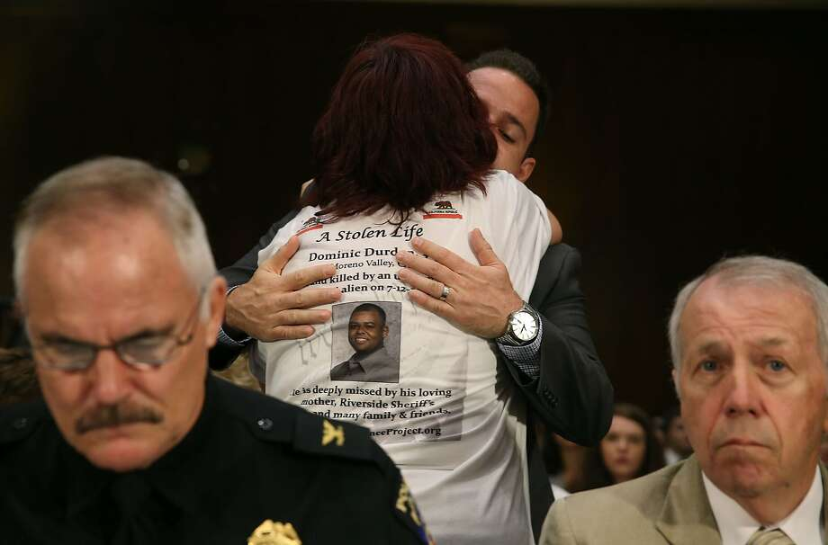 WASHINGTON, DC - JULY 21: Brad Steinle, brother of  Kathryn Steinle who was gunned down by an illegal immigrant in San Francisco, hugs a victims family member during a Senate Judiciary Committee hearing on Capitol Hill, July 21, 2015 in Washington, DC. The committee heard testimony from family members who have had loved ones killed by illegal immigrants. Also pictured are Chief J. Thomas Manger (L), Chief of Police in Montgomery County, Maryland, and Brian McCann (R). (Photo by Mark Wilson/Getty Images) Photo: Mark Wilson, Getty Images