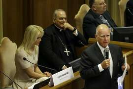 California Gov. Jerry Brown, right, delivers his speech in the Synod Hall as he attends a conference on Modern Slavery and Climate Change at the Vatican, Tuesday, July 21, 2015. Dozens of environmentally friendly mayors from around the world are meeting at the Vatican this week to bask in the star power of eco-Pope Francis and commit to reducing global warming and helping the urban poor deal with its effects. (AP Photo/Gregorio Borgia)