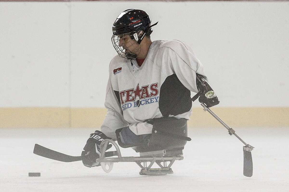 STARskaters sled hockey team member Joseph Montomayor, a triple amputee, practices manuevers on the ice during a practice session at Memorial City Mall. The program was started by Sugar Land resident Jim O'Neill. Another Sugar Land resident, B.L. Wylie, started