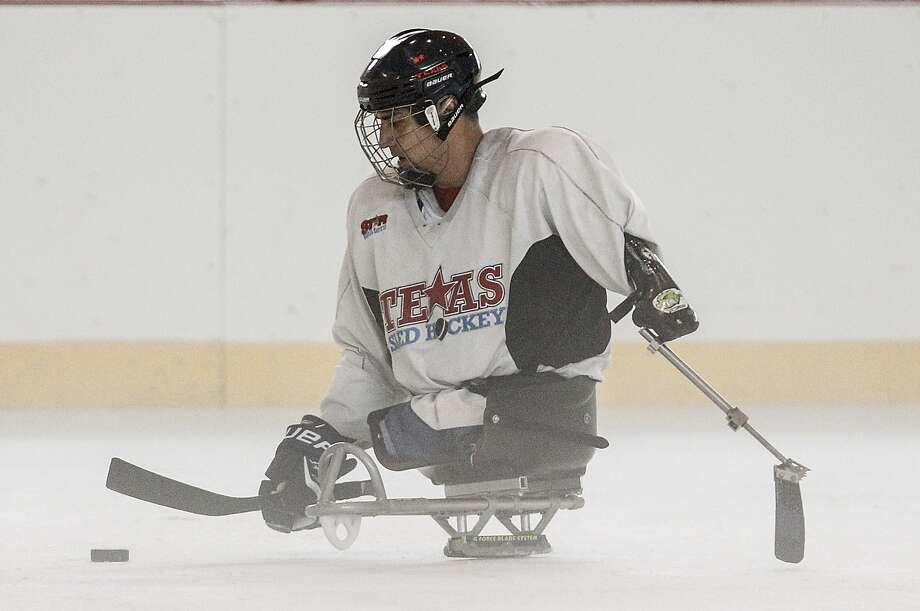 "STARskaters sled hockey team member Joseph Montomayor, a triple amputee, practices manuevers on the ice during a practice session at Memorial City Mall. The program was started by Sugar Land resident Jim O'Neill. Another Sugar Land resident, B.L. Wylie, started ""Skate Therapy,"" a figure skating program for those with disabilities.       STARskaters sled hockey team member Joseph Montomayor, a triple amputee, practices manuevers on the ice during a practice session at Memorial City Mall. The program was started by Sugar Land resident Jim O'Neill. Another Sugar Land resident, B.L. Wylie, started ""Skate Therapy,"" a figure skating program for those with disabilities. Photo: Diana L. Porter, Freelance / © Diana L. Porter"