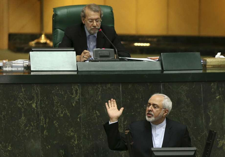 Iranian Foreign Minister Mohammad Javad Zarif addresses parliament while speaker Ali Larijani sits above, in an open session of parliament in Tehran. Photo: Vahid Salemi, Associated Press