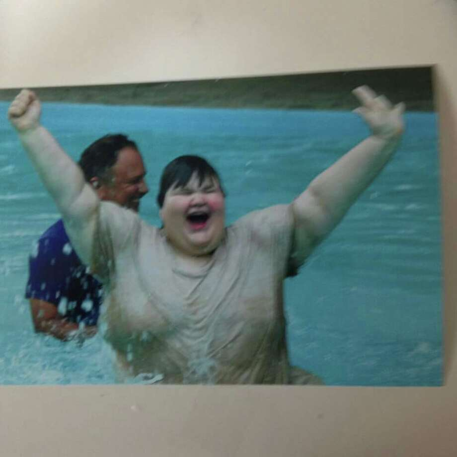 Splashtown, the popular place for San Antonians to keep cool, is embroiled in a heated controversy with the family of an autistic child who was supposedly made a laughing stock by the park's lifeguards. Photo: Tracy Macaitis Dean