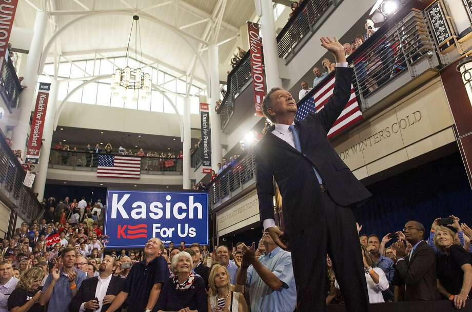 Ohio Gov. John Kasich waves to the crowd after giving his speech announcing his presidential candidacy. Photo: Ty Wright