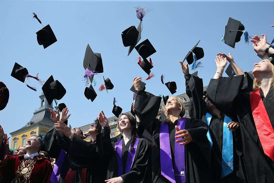 BONN, GERMANY - JULY 04:  Students throw up their graduate caps during the 11th celebrations of the Rheinische Friedrich-Wilhelms-Universitaet on July 4, 2015 in Bonn, Germany. This year, 780 women and 293 men finished their studies successfully.  (Photo by Andreas Rentz/Getty Images) Photo: Andreas Rentz, Getty Images