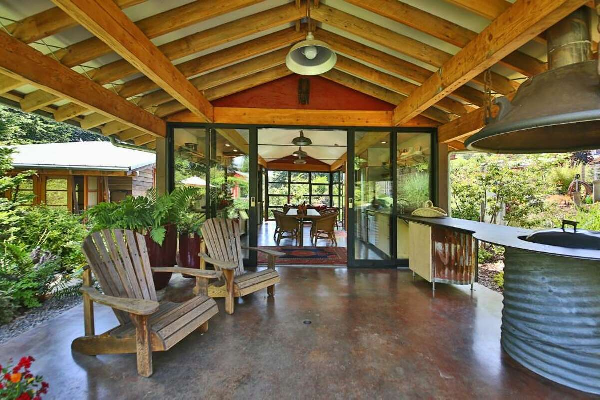 A covered outdoor patio and cooking area at 870 Grace Lane.