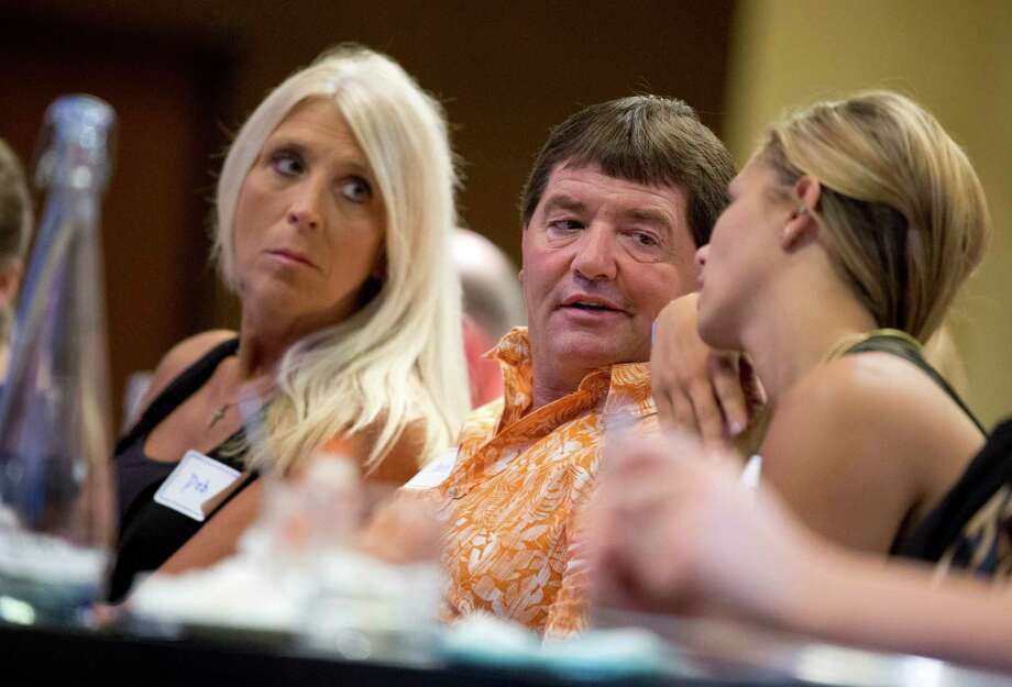 Dean DeMoe, center, with his wife, Deb DeMoe, left, and their daughter McKenna DeMoe, 19, right, attend the Alzheimer's Association International Conference in Washington, Saturday, July 18, 2015. Alzheimer's has ravaged generations of Dean DeMoe's family _ his grandmother, father, siblings _ all in their 40s and 50s. DeMoe, too, inherited the culprit gene mutation and at 53, the North Dakota man volunteers for a drug study he hopes one day will end the family's burden.  (AP Photo/Manuel Balce Ceneta) Photo: Manuel Balce Ceneta, STF / AP