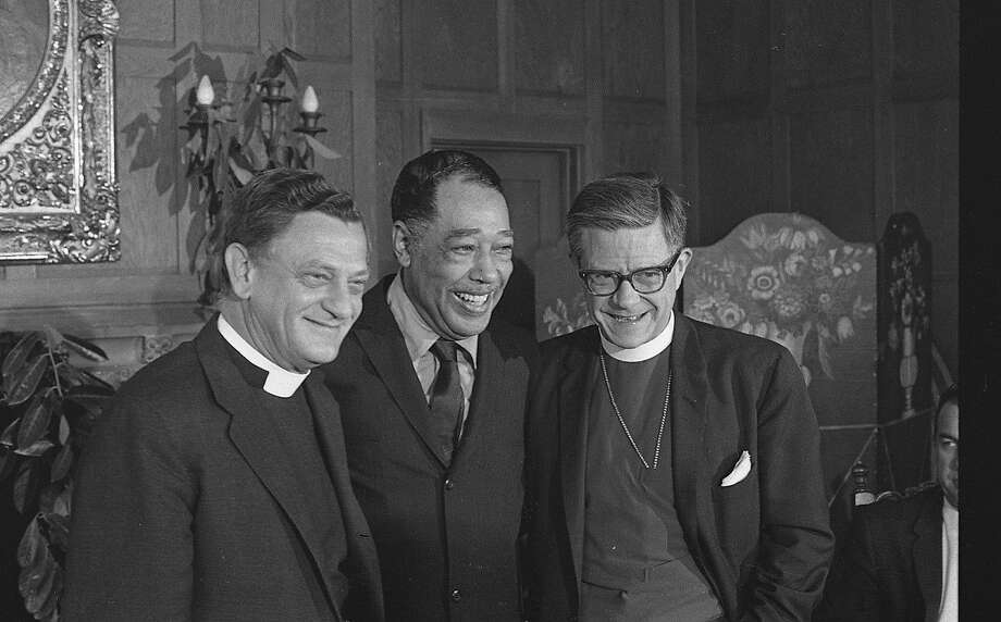 Duke Ellington (center)  and Reverend C. Julian Bartlett (left) and Bishop James Pike (right) meet to announce that Duke Ellington will compose a piece and perform a sacred music concert to celebrate the opening of Grace Cathedral photos shot 08/26/1965 Photo: Art Frisch, The Chronicle