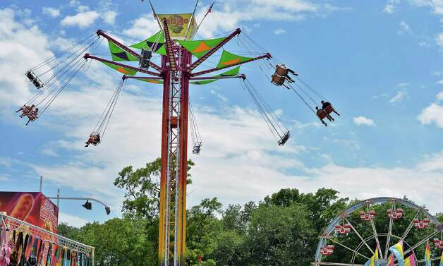 Intrepid fair goers  ride the Vertigo as the Saratoga County Fair begins Tuesday July 21, 2015 in Ballston Spa, NY.  (John Carl D'Annibale / Times Union) Photo: John Carl D'Annibale / 00032674A