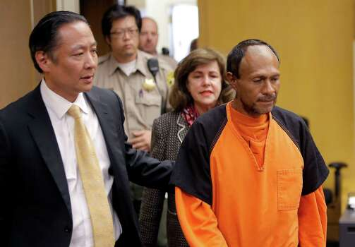Juan Francisco Lopez-Sanchez, right, with his public defender Jeff Adachi, left, at Lopez-Sanchez's arraignment in San Francisco this month. Lopez-Sanchez, a Mexican laborer with a lengthy criminal record who was previously deported for the U.S., pleaded not guilty in the murder of Kathryn Steinle on Pier 14 in San Francisco in what police described as a random shooting. Photo: MICHAEL MACOR /New York Times / POOL