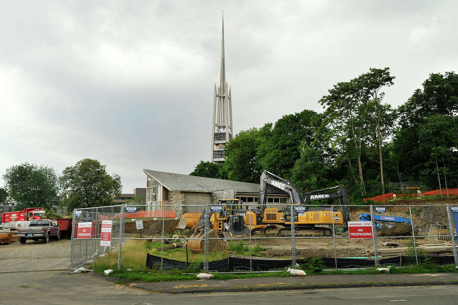1101 Bedford street:  Construction can be seen behind the First Presbyterian Church in Stamford, Conn., on Wednesday, July 8, 2015. The land used to belong to the church but is now becoming apartments. Photo: Jason Rearick / Hearst Connecticut Media / Stamford Advocate