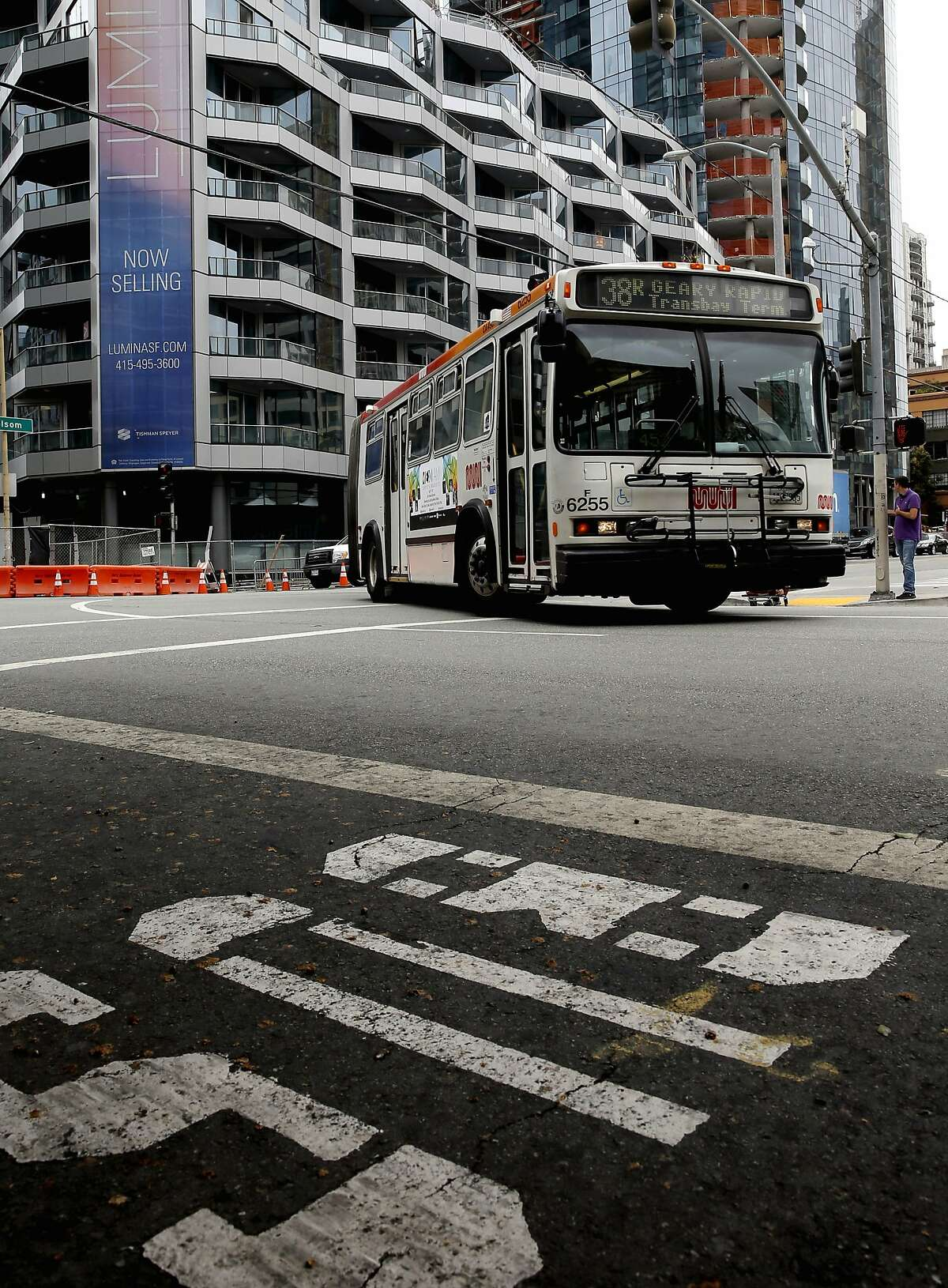 Residential construction is seen on the corner of Folsom and Main Streets as a MUNI bus pulls into the Transbay Terminal, in San Francisco, Calif., on Tues. July 21, 2015. San Francisco Mayor ED Lee announced today a plan to charge transit development fees on residential, office and commercial construction projects.