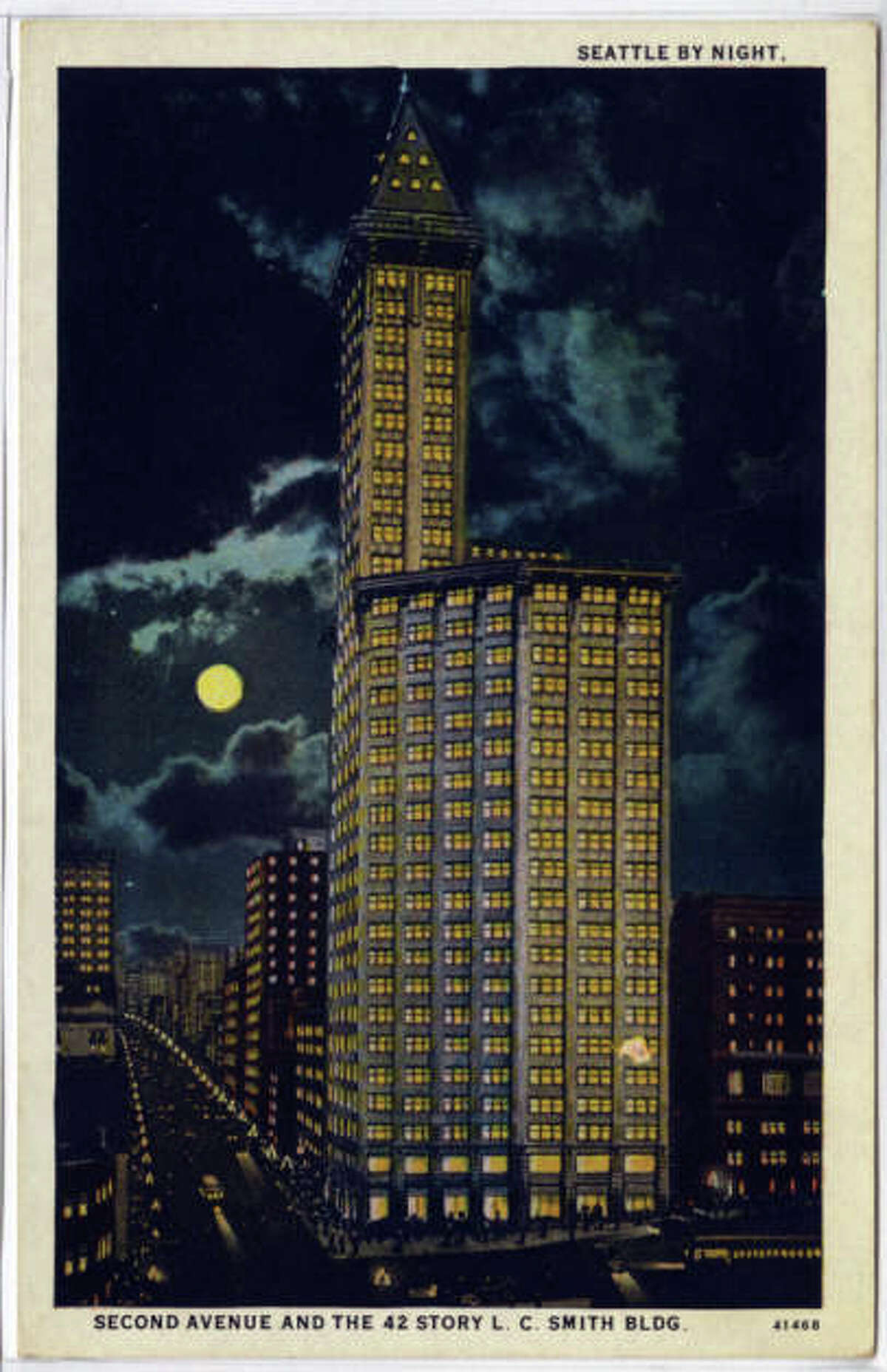 Seattle's Smith Tower pictured lighted at night. The printed description in the undated postcard reads as follows: