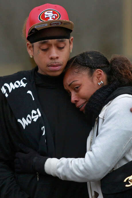 Quintina Jones embraces her brother, George Jones, during the 1st Year Angelversary for their cousin Marquise Jones, at Chaco's in San Antonio on Saturday, Feb. 28, 2015. Marquise Jones was shot by an off-duty SAPD officer in the drive-through at Chacho's on Perrin Beitel Road on Feb. 28, 2014. Photo: Lisa Krantz / Lisa Krantz/San Antonio Express- / San Antonio Express-News