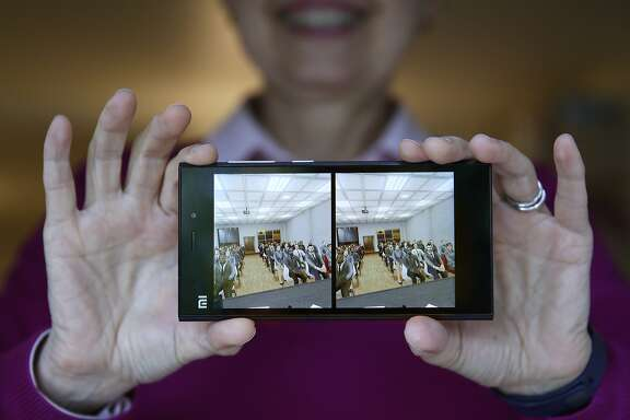 Clinical psychologist Elizabeth McMahon, Ph.D, shows the video images  used in a 3D viewer for Psious virtual reality technology to help treat patient anxiety disorders in San Francisco, Calif., on Tuesday, July 21, 2015.   The video shown is used to treat patients with fear of public speaking.