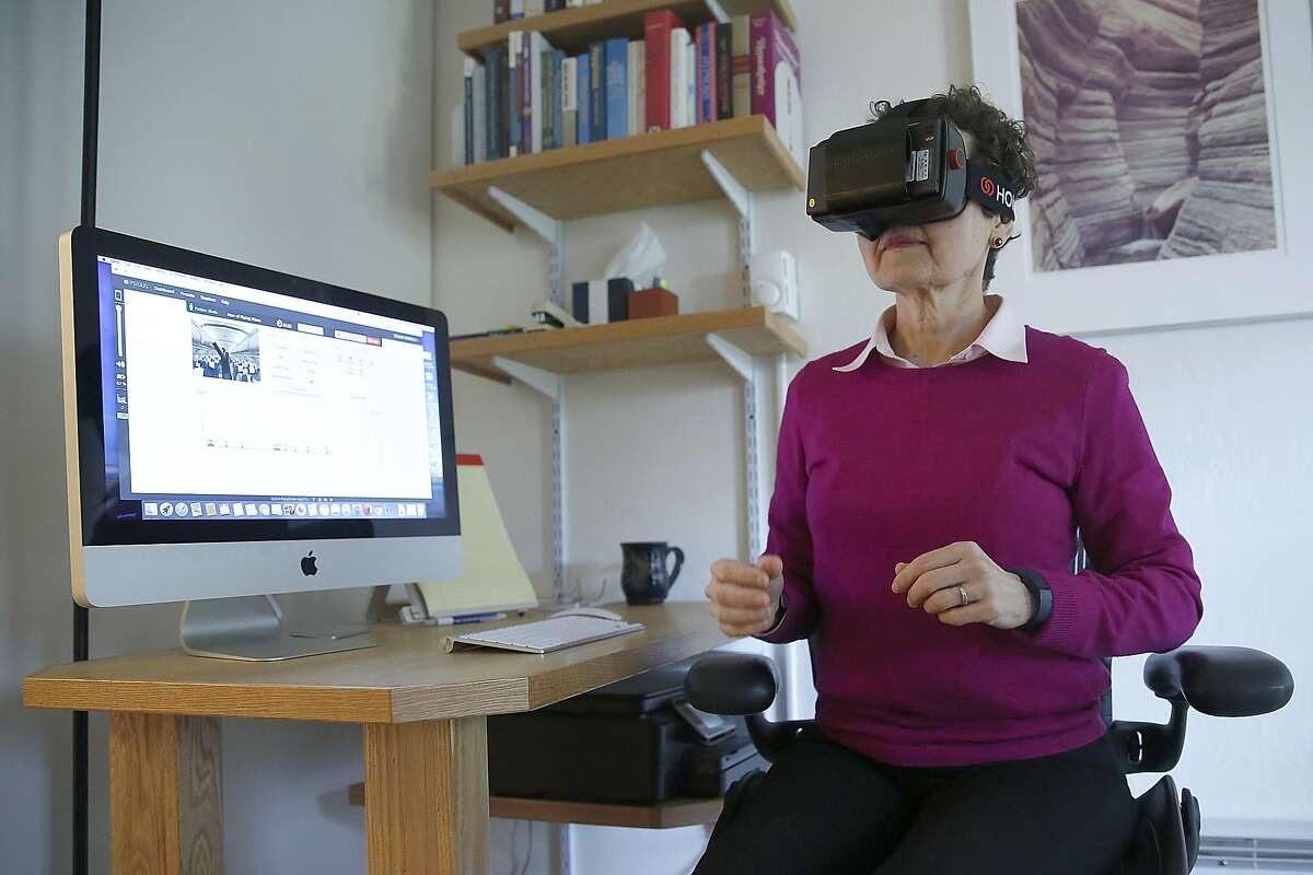 Clinical psychologist Elizabeth McMahon, Ph.D, shows her use of Psious virtual reality technology to help treat patient anxiety disorders in San Francisco, Calif., on Tuesday, July 21, 2015.