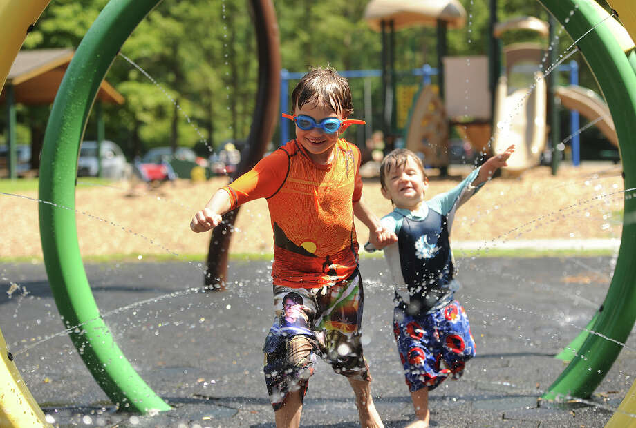 Cool off with a run through the sprinkler park at Lake Mohegan in Fairfield. Photo: Brian A. Pounds, Hearst Connecticut Media / Connecticut Post