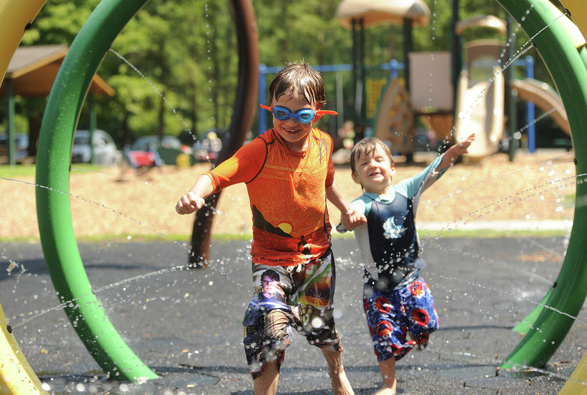 Cool off with a run through the sprinkler park at Lake Mohegan in Fairfield.