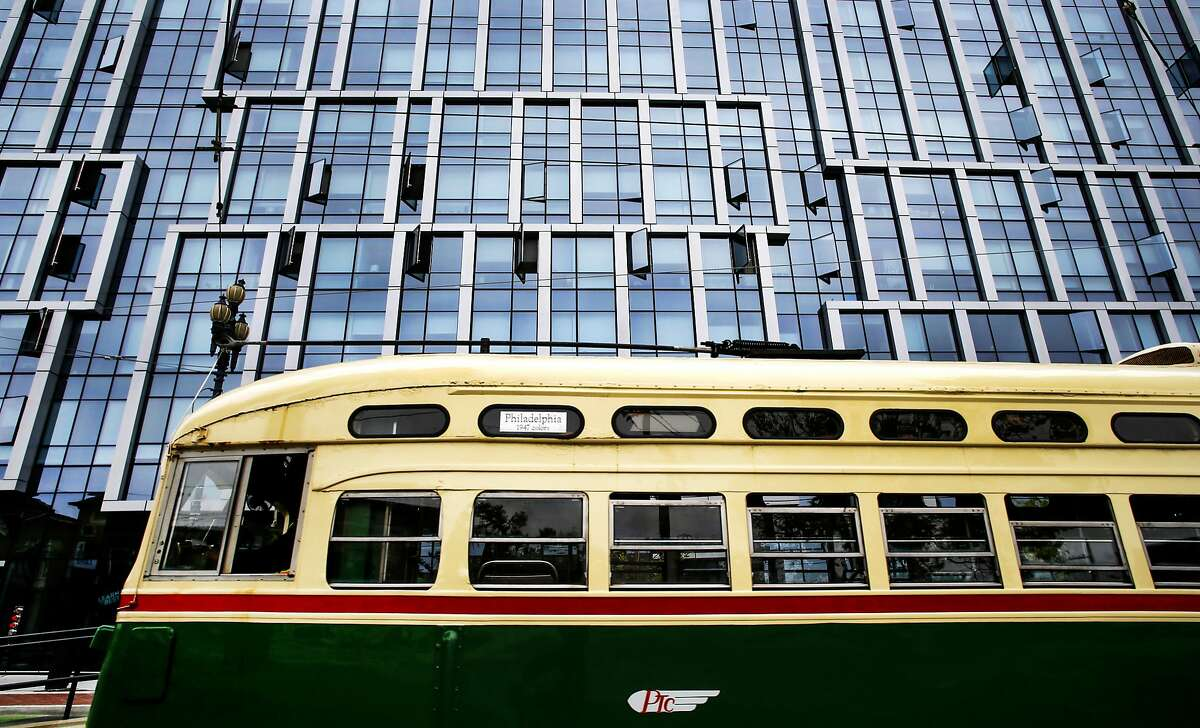 A MUNI streetcar passes by the newly completed condo and retail complex on the corner of Buchanan and Market streets, in San Francisco, Calif., on Tues. July 21, 2015. San Francisco Mayor ED Lee announced today a plan to charge transit development fees on residential, office and commercial construction projects.
