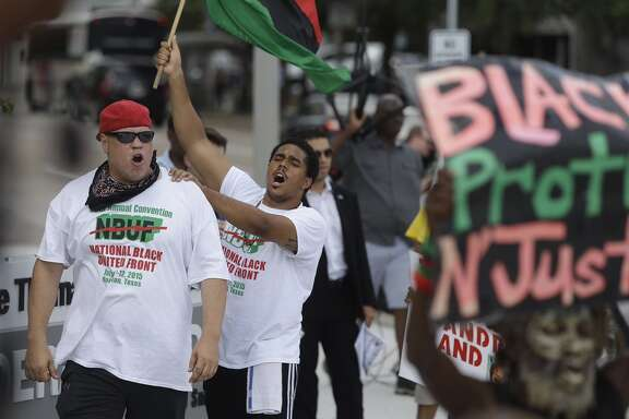 Supporters with the National Black United Front rally outside the Federal Building along Smith Street in downtown Houston on Tuesday.