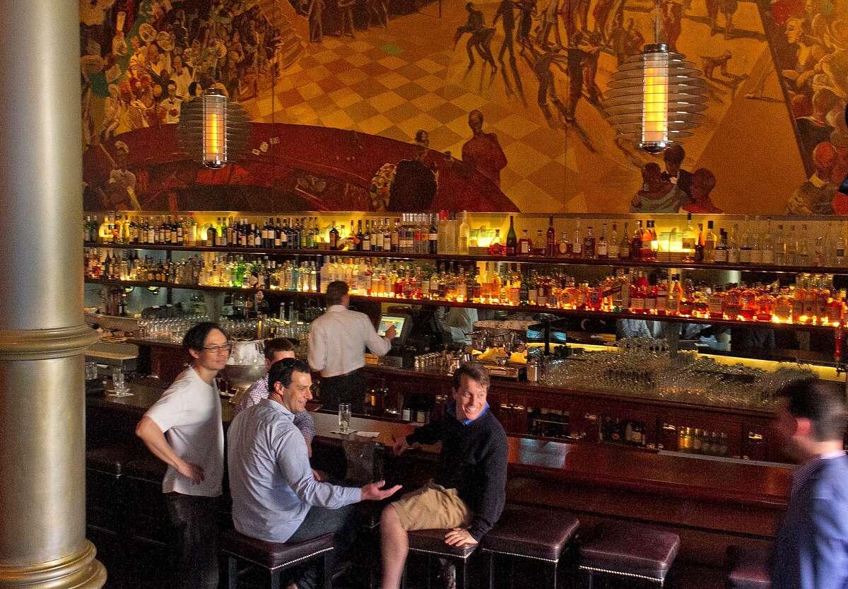People enjoy cocktails at Bix restaurant in San Francisco, Calif., on Sunday, June 10th, 2012.