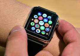 """A South Korean employee shows the """"Apple Watch"""" at an Apple shop in Seoul on June 26, 2015. Apple Watch on June 26 arrived in seven more countries including South Korea, Italy, Mexico, Singapore, Spain, Switzerland and Taiwan, after the US tech giant released its first smartwatch in April in nine countries including the United States, China and Japan.  AFP PHOTO / JUNG YEON-JEJUNG YEON-JE/AFP/Getty Images"""
