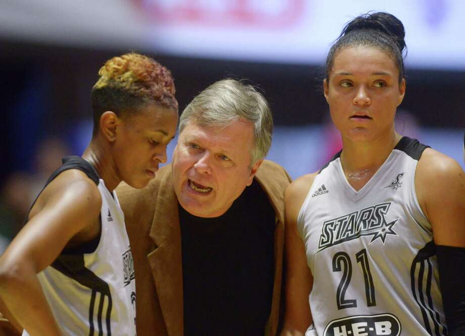 San Antonio Stars coach Dan Hughes speaks with Danielle Robinson, left, and Kayla McBride during a timeout against the Indiana Fever at Freeman Coliseum on July 21, 2015. Photo: Billy Calzada /San Antonio Express-News / San Antonio Express-News