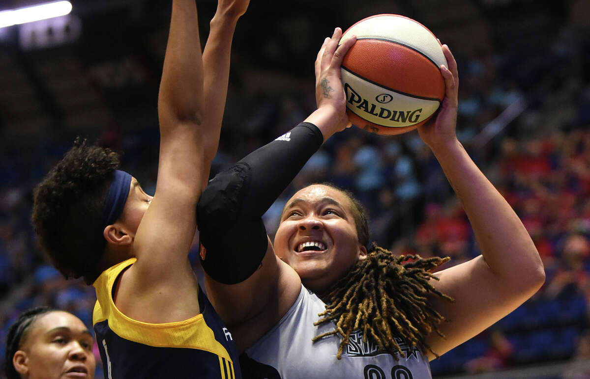 Danielle Adams of the San Antonio Stars shoots over Layshia Clarendon of the Indiana Fever during WNBA action at Freeman Coliseum on Tuesday, July 21, 2015.