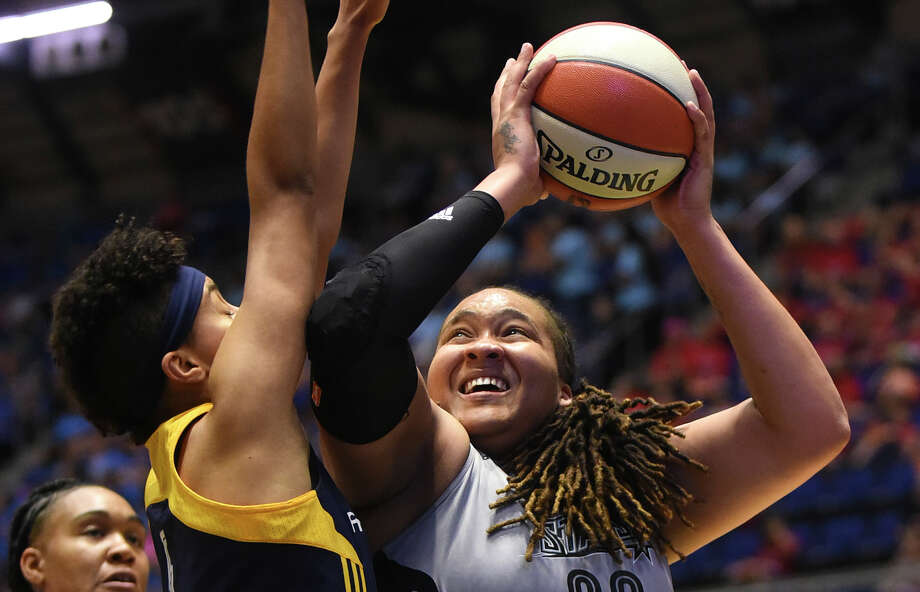 Danielle Adams of the San Antonio Stars shoots over Layshia Clarendon of the Indiana Fever during WNBA action at Freeman Coliseum on Tuesday, July 21, 2015. Photo: Billy Calzada, Staff / San Antonio Express-News / San Antonio Express-News