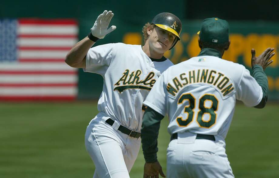 athletics103_mac.jpg  A's 22- Eric Byrnes rounds 3rd base and gives a high-five to Ron Washington after a 3 run homer in the 4th inning. Oakland Athletics Vs. Texas Rangers.6/19/03 in Oakland.  MICHAEL MACOR / The Chronicle Photo: Michael Macor, SFC