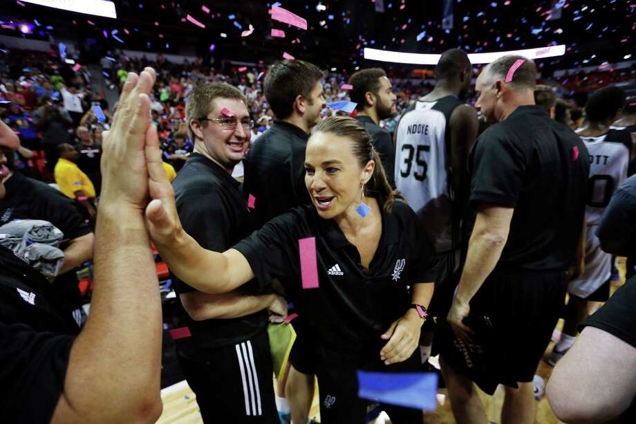 San Antonio Spurs coach Becky Hammon celebrates with her team after they defeated the Phoenix Suns in an NBA summer league championship basketball game Monday, July 20, 2015, in Las Vegas. (AP Photo/John Locher) Photo: John Locher, STF / Associated Press / AP