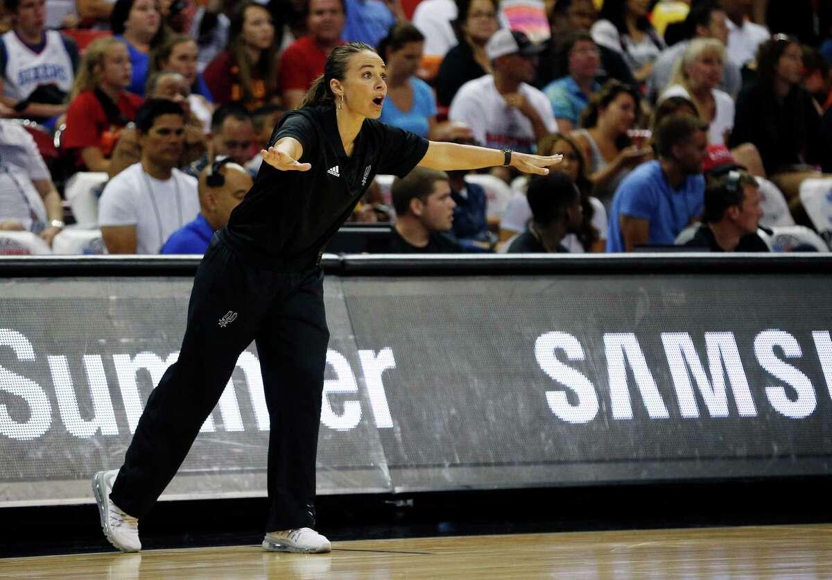 Becky Hammon coaches the San Antonio Spurs against the Phoenix Suns in an NBA summer league championship basketball game Monday, July 20, 2015, in Las Vegas. (AP Photo/John Locher)