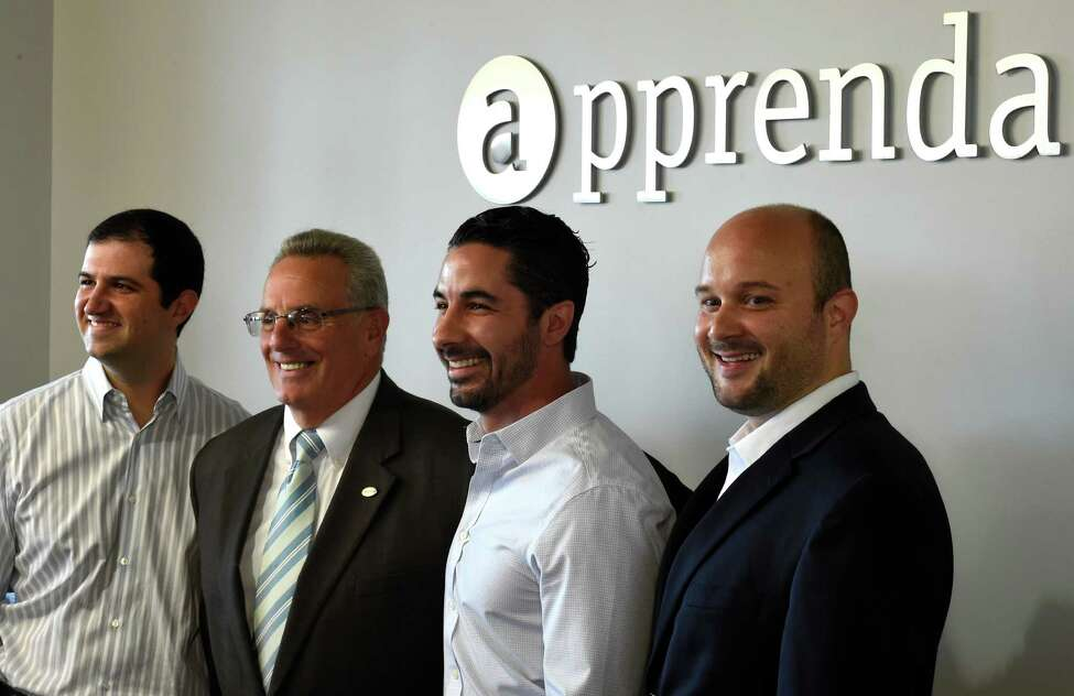 Apprenda co-founders Abraham Sultan, left Sinclair Schuller, second from right and Matt Ammerman are joined by Troy Mayor Lou Rosamilia, second from left for the announcement of the receipt of $24M in funding for Apprenda, Tuesday morning July 21, 2015 in Troy, N.Y. Apprenda provides software to help those more legacy-minded institutions take advantage of advanced cloud computing without having to rewrite all of their code. (Skip Dickstein/Times Union)