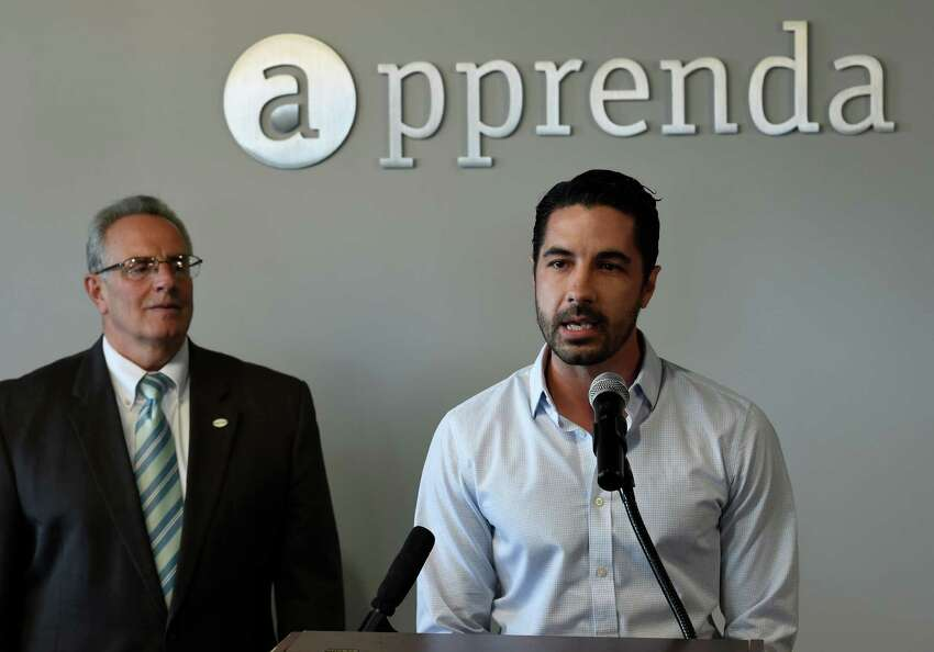 Sinclair Schuller, CEO, right is joined by Troy Mayor Lou Rosamilia, left for the announcement of the receipt of $24M in funding for Apprenda, Tuesday morning July 21, 2015 in Troy, N.Y. Apprenda provides software to help those more legacy-minded institutions take advantage of advanced cloud computing without having to rewrite all of their code. (Skip Dickstein/Times Union)