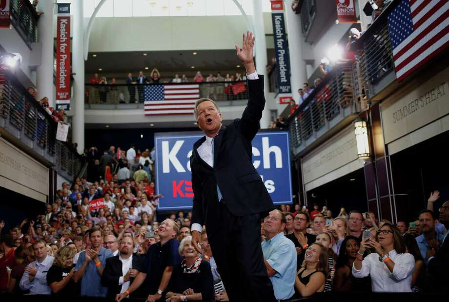 John Kasich, governor of Ohio, gestures after announcing he will seek the 2016 Republican presidential nomination in Columbus, Ohio, U.S., on Tuesday, July 21, 2015. Kasich, seeking to emerge from a crowded Republican presidential field as a practical and compassionate leader from a must-win swing state, is joins 15 other Republicans who have declared their candidacies. Photographer: Luke Sharrett/Bloomberg *** Local Caption *** John Kasich Photo: Luke Sharett / Bloomberg / © 2015 Bloomberg Finance LP