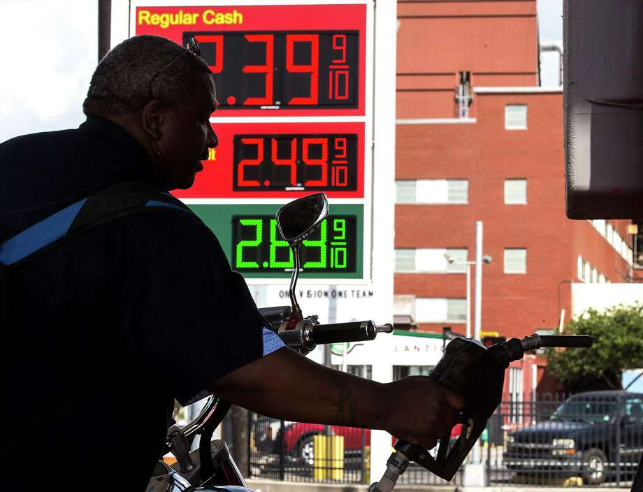 Dana Montana replaces the gasoline nozzle after putting gas in his motorcycle at King Fuels at the intersection of Harrisburg and Milby on Monday, July 20, 2015, in Houston. Gas was priced at $2.39 a gallon, cash price, at the station. ( Brett Coomer / Houston Chronicle ) Photo: Brett Coomer, Staff / © 2015 Houston Chronicle
