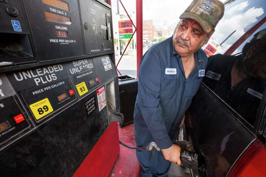 Monico Hernandez fills his tank at in Houston. The average price for a gallon of regular gas in Texas is $2.56, less than the national average of $2.75 but a bit higher than the San Antonio average of $2.50. Photo: Brett Coomer /Houston Chronicle / © 2015 Houston Chronicle