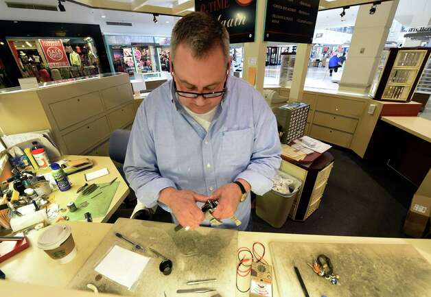 Michael Laiacona carefully checks the works of a watch at his kiosk Time & Time Again Tuesday morning July 21, 2105 in Colonie Center in Colonie, N.Y.       (Skip Dickstein/Times Union) Photo: SKIP DICKSTEIN / 00032689A