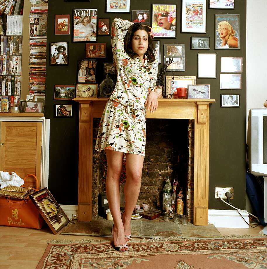 "5_Amy_Winehouse_.jpg Caption: A personal photo from the new exhibition ""Amy Winehouse: A Family Portrait"" at the Contemporary Jewish Museum July 30–Nov. 1, 2015. Credit: Mark Okoh, Camera Press London  D 32808-05  Amy Winehouse  Obligatory Credit - CAMERA PRESS/Mark Okoh SPECIAL PRICE APPLIES. Jazz and soul singer Amy Winehouse poses for photos at her home in Camden, London.  Her debut album 'Frank' won an  Ivor Novello award and was released in October 2003.     2004 Photo: Mark Okoh, Camera Press London"