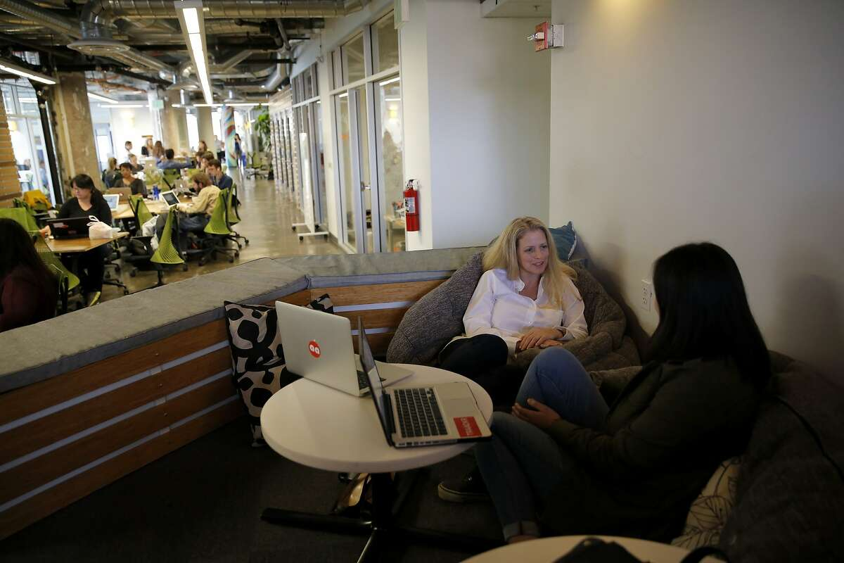 Amy Kelman (right) talks with Jennifer Mak at the Impact Hub offices in San Francisco, California, on Tuesday, July 21, 2015. The co-working space is celebrating its five-year anniversary.