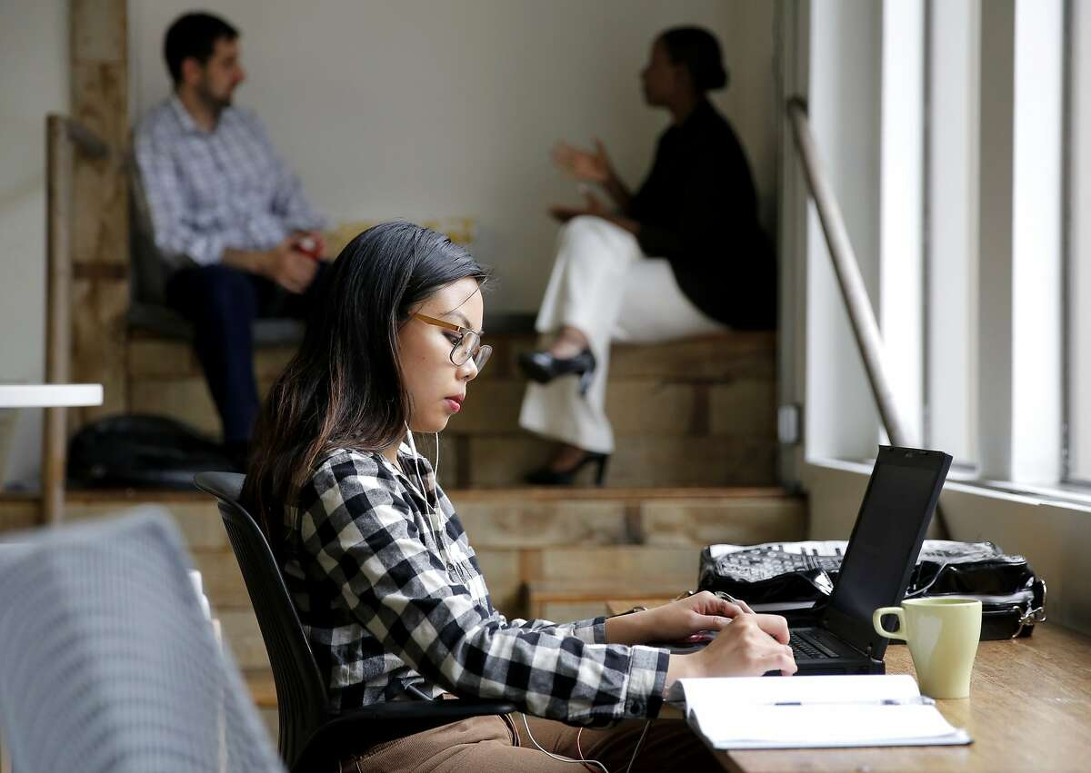 April Phomthavong works at the Impact Hub offices in San Francisco, California, on Tuesday, July 21, 2015. The co-working space is celebrating its five-year anniversary this year.
