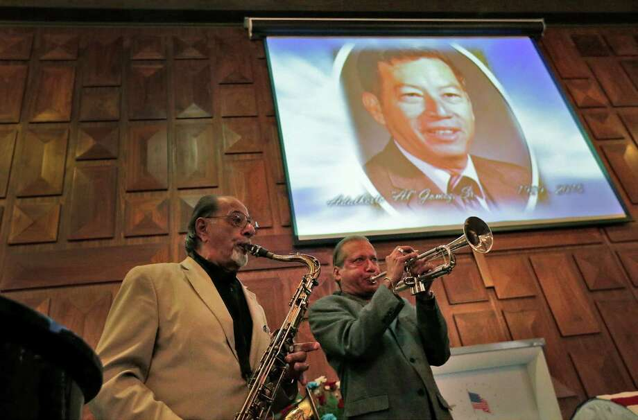 Al Gomez, Jr. (right) and saxophonist John Magaldi play in tribute to Gomez's father, Adalberto Gomez, Sr., during visitation services at Mission Park Funeral Chapel on Tuesday, July 21, 2015. Gomez, Sr. was a lifelong musician who played the trombone in his band, The Al Gomez Family Band. Gomez, Sr. was honored during the visitation with music by his son and his daughter, Linda Richter. He was 86. (Kin Man Hui/San Antonio Express-News) Photo: Kin Man Hui, Staff / San Antonio Express-News / ©2015 San Antonio Express-News