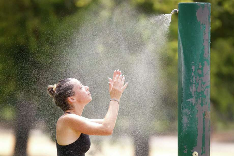 """""""It's hot, but with cooling areas, I'm good,"""" said jogger Florence Hirner on Tuesday in Memorial Park. Photo: Steve Gonzales, Staff / © 2015 Houston Chronicle"""