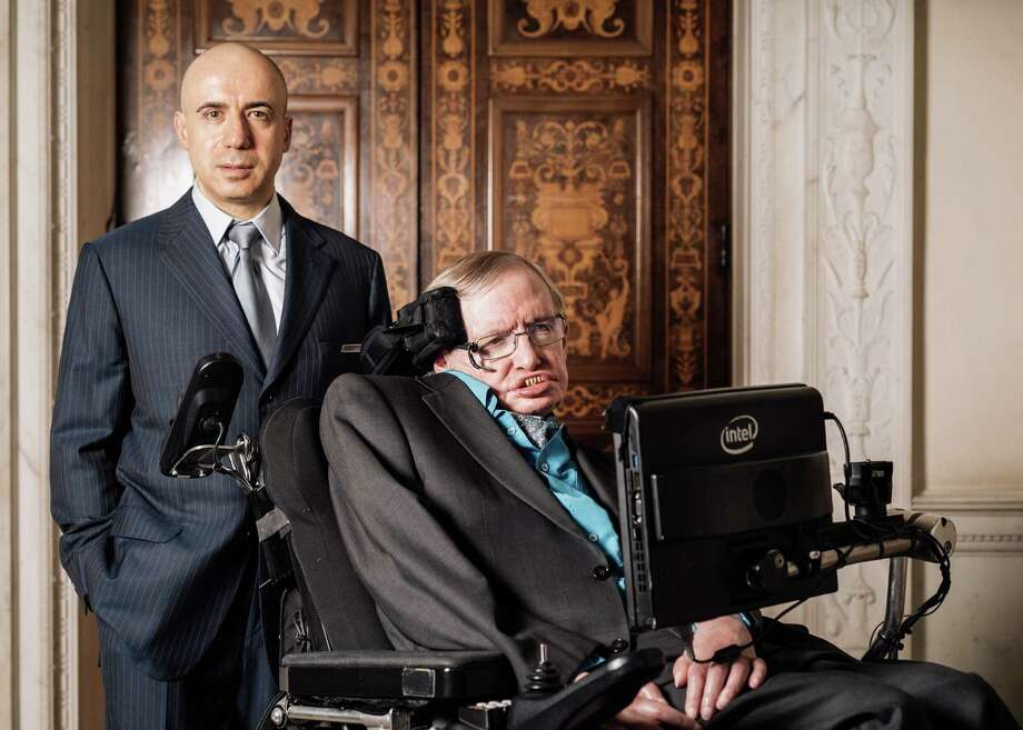 Yuri Milner and Stephen Hawking unveil the project at the Royal Society in London. Among members of its brain trust is Houston artist Dario Robleto.  Photo: TOM JAMIESON, STR / NYTNS