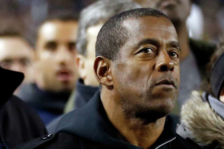 In this Nov. 9, 2013, file photo, former Pittsburgh and NFL Hall of Fame running back Tony Dorsett stands on the sideline before the start of an NCAA football game between Pittsburgh and Notre Dame in Pittsburgh. Dorsett is one of more than 4,500 former players that have filed suit, some accusing the NFL football league of fraud for its handling of concussions. A federal judge on Tuesday, Jan. 14, 2014, denied preliminary approval of a $765 million settlement of NFL concussion claims, fearing it may not be enough to cover 20,000 retired players. (AP Photo/Keith Srakocic, File) Photo: Keith Srakocic, STF / AP