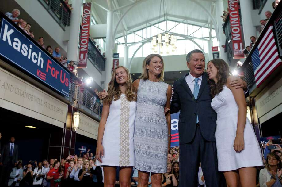 Ohio Gov. John Kasich stands with his wife, Karen, and daughters Emma, left, and Reese after announcing his candidacy for the Republican Party's nomination for the 2016 presidential election during a campaign rally Tuesday at Ohio State University in Columbus, Ohio. Photo: John Minchillo, STF / AP