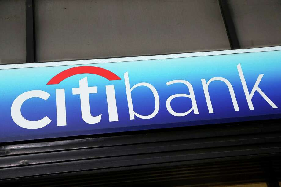 """FILE - In this Jan. 15, 2015 photo, a Citibank sign hangs above a branch office in New York. The Consumer Financial Protection Bureau on Tuesday, July 21, 2015 said that Citi will have to issue refunds to 8.8 million affected consumers who paid for credit card add-on products and services, like credit score monitoring or """"rush"""" processing of payments. (AP Photo/Mark Lennihan, File) Photo: Mark Lennihan, STF / AP"""