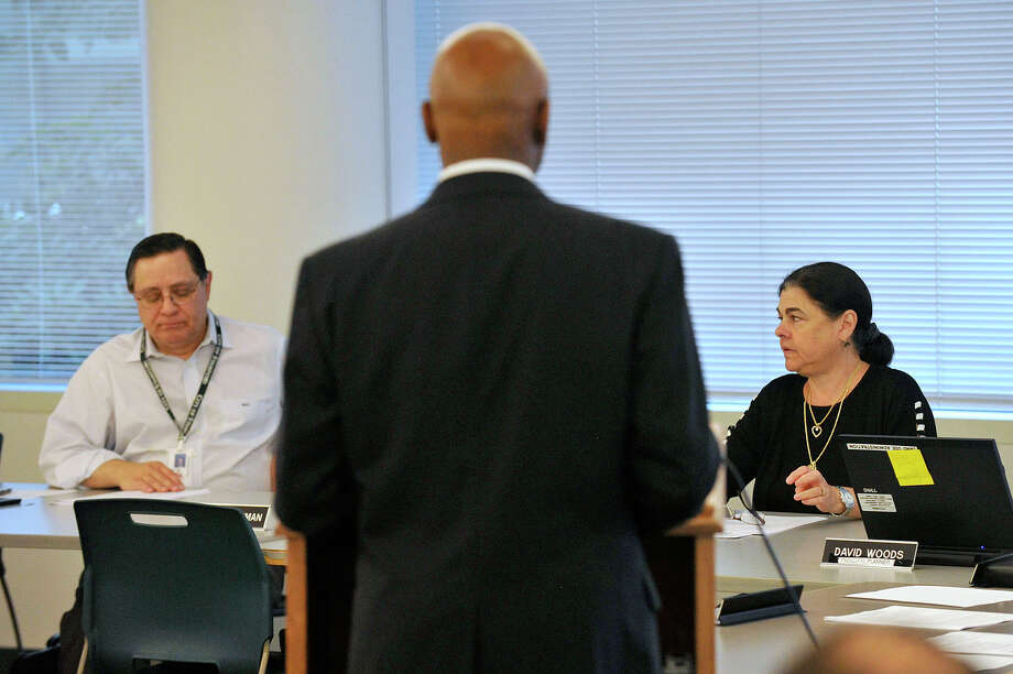 Planning Board member Michael Totilo, left, and Chairman Theresa Dell, right, listen as Michael Pollard, chief of staff to the mayor, speaks during the Planning Board meeting regarding the future of the Yerwood Center at the Stamford Government Center in Stamford, Conn., on Tuesday, July 21, 2015. Photo: Jason Rearick / Hearst Connecticut Media / Stamford Advocate