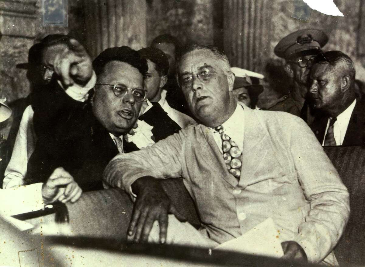 Congressman Maury Maverick Sr. points out the new U.S. Post Office to President Franklin Delano Roosevelt while riding in a car near the Alamo in 1936.