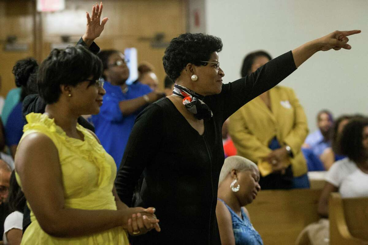 Geneva Reed-Veal, mother of Sandra Bland, center, reacts as her daughter is celebrated during a memorial service for Bland at All Faiths Chapel on the campus of Prairie View A&M University on Tuesday, July 21, 2015, in Houston. Bland, a 28-year-old African American woman, was arrested July 10, after being stopped by a Department of Public Safety trooper for failing to signal a lane change. A DPS spokesman said she was arrested after becoming
