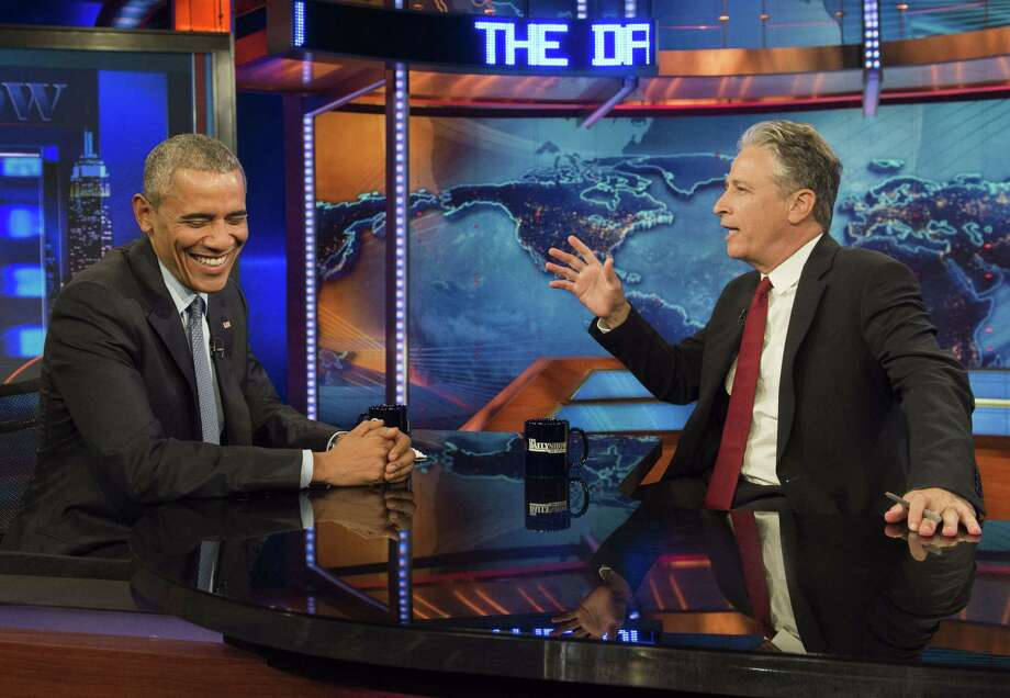 "President Barack Obama, in his second term, and outgoing TV host Jon Stewart talk on ""The Daily Show with Jon Stewart"" on Tuesday. Photo: SAUL LOEB, Staff / AFP"
